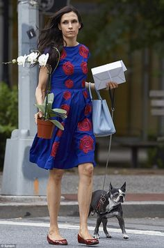 Famke Janssen shone on the streets of New York in a summery blue and red dress http://dailym.ai/1ufrrSJ