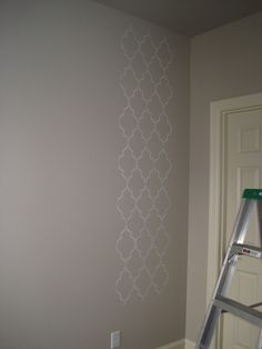 Design Tip: Stenciling a wall? Use a small hanging level to make sure as you go along the stencil stays perfectly level.