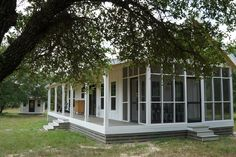 This is a tiny house and small cottage combo by Kanga Room Systems in Texas. The main cottage is and the tiny house is