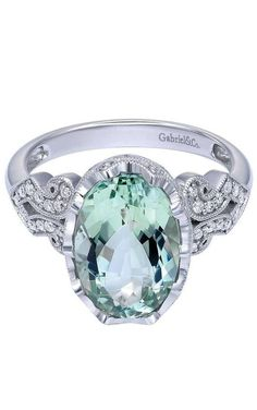 This gorgeous 14k White Gold Diamond Green Amethyst Ring by Gabriel & Co. is absolutely amazing. The color is so stunning while all the little diamonds add such shine and sparkle. Discover your color pop jewelry with Gabriel & Co.
