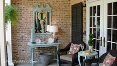 Add a painted mirror to a covered porch to bring the indoors out! #porch #southernporch #porchdecor