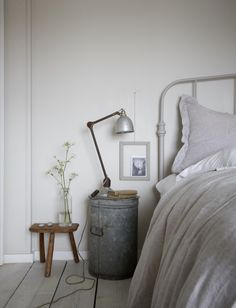 gray bedroom with pop of color love this simple rustic seaside coastal bedroom with whitewashed floorboards industrial lamp and galvanised metal table and pale grey walls Gray Bedroom, Trendy Bedroom, Grey Bedroom With Pop Of Color, Cottage Style Decor, Coastal Bedrooms, Seaside Bedroom, Farmhouse Bedrooms, Country Bedrooms, Am Meer