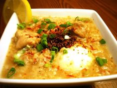Arroz Caldo - another way of preparing glutinous rice resembling risotto. It's boiled with chicken, safflower, ginger topped with scallions and toasted garlic.