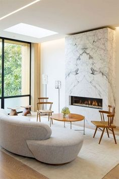 reveal at top of fireplace, marble, bookmatched, neutral scheme