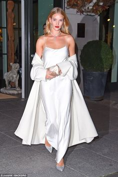 Hello, gorgeous: Rosie Huntington-Whiteley was photographed in New York Wednesday night in a sleeveless white gown redolent of Old Hollywood
