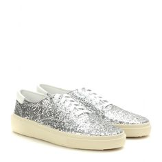Saint Laurent - Glitter-embellished sneakers - These sparkling sneakers from Saint Laurent will lift the simplest of looks. Coated in silver glitter with contrasting white laces and with the brand's subtle logo embossed on the heel, they're a cool alternative to the feminine ballerina. seen @ www.mytheresa.com
