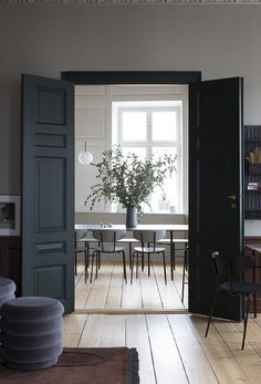 Charcoal grey double doors looking onto the dining room #greydoors #darkwalls #diningroominspiration #diningroomdecor