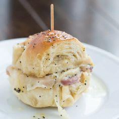 These are the best ham and cheese sliders we've ever had and they have a yummy poppy seed dressing!