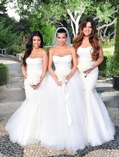 Kim decked her bridesmaid sisters Khloe and Kourtney in their own white Vera Wang gowns.