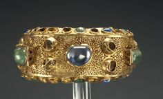 Bracelet. Artist/Maker(s): Unknown. Culture: Roman. Place(s): Roman Empire (Place created). Date: 250 - 400. Medium: Gold, emeralds, sapphires, and glass.