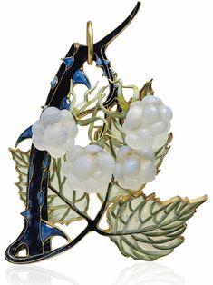AN ART NOUVEAU ENAMEL AND GLASS PENDANT, BY RENÉ LALIQUE. Modelled as a spray of raspberries, the deep blue enamel stem with lighter blue enamel thorns, with four opalescent glass raspberries and window enamel leaves, 1902, 8.5 cm, mounted in gold. Signed Lalique. #RenéLalique #ArtNouveau #Jewelry #Jewellery #BijouxArtNouveau