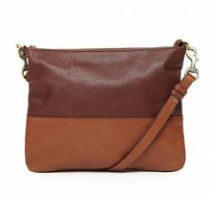 Zip top two tone leather bag with adjustable across body strap. The inside is fully lined with a floral cotton. Perfect for use day and night! Features: - Zip closure - Adjustable across body strap Lining: Floral cotton Materials: LEATHER H22CM X L27CM X D2CM Strap drop 60CM