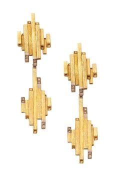 Andrew Grima detachable ear pendants featuring brilliant-cut diamonds.
