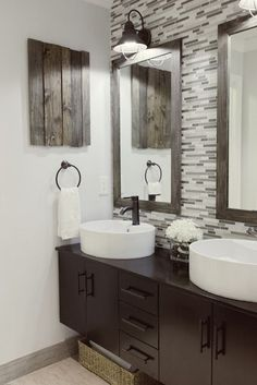Love that wall behind the framed wooden mirrors!