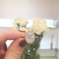 This beautiful ring with a custom halo featuring diamonds gradually increasing in size recently made its way onto one lucky girl's hand // email us for custom inquiries, info@mflynnjewelry.com #showmeyourrings