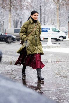 Caroline Issa wearing a burgundy midi skirt long military green jacket black boots and beige bag is seen outside Chanel show during Paris Fashion. Green Puffer Jacket, Khaki Jacket, Caroline Issa, Burgundy Fashion, Burgundy Skirt, Chanel, Dior Couture, Cool Street Fashion, Street Style Looks