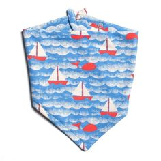 Adorable kerchief bib, with the new Winter Water Factory red sailboat scene print. Easy snap on, organic cotton, made in USA. Material: Organic Cotton Recommended for babies months Made In: Brooklyn, USA