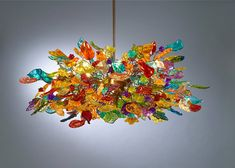 Hanging chandeliers Colorful flowers by Flowersinlight on Etsy  ...I absolutely love this shop, if you're looking for unusual lighting options, this is the place!!