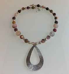 Mookite stone, Agate focal beads, pewter with SS overlay beads, pendant & toggle.
