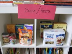 pretend play Grocery Store with real cans of food and weekly specials from newspaper