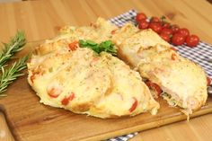INGREDIENTS 1 bag of sandwich bread 150g ham 200g provola cheese cherry tomatoes oregano 70g Parmesan cheese 2 eggs béchamel 50g fontina cheese   DIRECTIONS Spread the béchamel onto the slices of bread and place them in a pan so they form a wreath. Between each slice of bread put the ham, provola cheese and the tomatoes. Beat the eggs together with some béchamel, salt, and pepper. Pour the mixture over the sandwich bread cake. Add oregano and some fontina cheese and bake at 200°C for at…