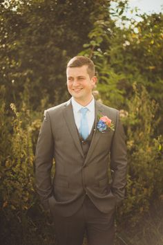 Groom wears a grey three piece suit with a light blue tue | Photography by http://alexapenberthy.com/