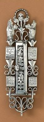 An ornate mezzuzah. Commanded by God to be used to identify a Jewish presence in the house, Jewish people today continue to place these pieces at their front door. Inside each and every mezzuzah is a copy of important passages from the Torah, in miniature. Recently a new Jewish neighbor stopped by to meet me - she had walked up and down our street looking for the familiar Mezzuzah!