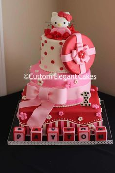 Hello Kitty Birthday Cake - Made this cake for my Grand-daughter's first birthday. All fondant, bottom tier vanilla second tier red velvet. Top tier made out of foam, Hello kitty, tissue, gift box top and bow made from Gumpaste, Letters are made with 2X2 blocks of gumpaste.