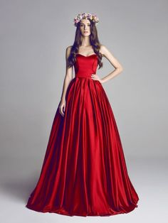 Red wedding dress ~~ If I ever get the chance to renew my vows with my S.O. I am going all out with a formal wedding now that gay marriages are legal here in Florida. I would definitely wear a blood red hooded Handfasting gown with a train a mile long with crystals all over the front down to the natural waist also in red. With a crown of red roses (Fake of course) LD.