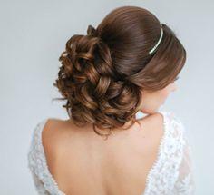 Classy and Elegant Wedding Hairstyles   Curled hair bun   Bridal up do