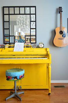happy yellow painted piano