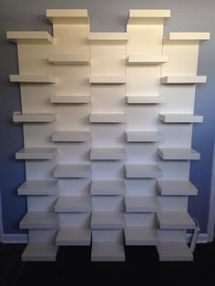 IKEA LACK White Wall shelf unit Such a simple way to get a very unique and striking bookshelf design Ikea Lack book shelves mounted together in a staggered pattern to c.