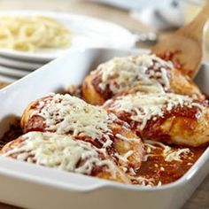Quick Chicken Parmesan - chicken, pasta sauce, any type of pasta, parmesan cheese, mozzarella cheese & any spices you want