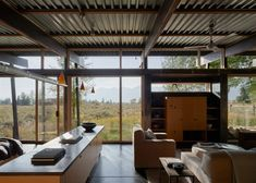 Floor-to-ceiling glazing in the living areas frame views of the Teton mountain range. Elegant Home Decor, Elegant Homes, Indoor Slides, Pole Barn Homes, Mountain Homes, Architect House, Japanese House, Cabins In The Woods, Residential Architecture