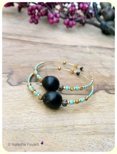 Ethnic chic / gypsy style earrings. Large gold rings with natural black seeds, turquoise coco wood beads and miyuki. © Natacha Fayard  #ethnic #chic #style #hoops #gypsy #gipsy #earrings #large #gold #rings #seeds #turquoise #miyuki #bohemian