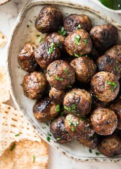 Juicy Greek Meatballs beautifully flavoured with red onion, fresh parsley, a touch of mint and hint of dried oregano. Serve with pita bread and tzatiki!