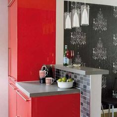 modern kitchen cabinets in red color and black wallpaper. Love that wallpaper!!