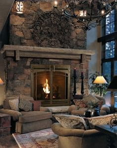 Stone Fireplace with mantle and hearth it's ok but I really like the furniture sitting in front of fireplace.