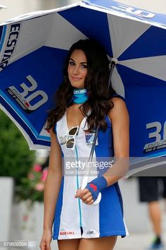 A Suzuki umbrella girl poses for a picture during the Indianapolis Red Bull MOTO GP at the Indianapolis Motor Speedway Indianapolis, IN. Get premium, high resolution news photos at Getty Images Race Car Girls, Car Show Girls, Umbrella Girl Motogp, Monster Energy Girls, Pit Girls, Promo Girls, Hot Cheerleaders, Girls Uniforms, Girl Poses