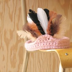 Make with chicken feathers for the chicken queen.