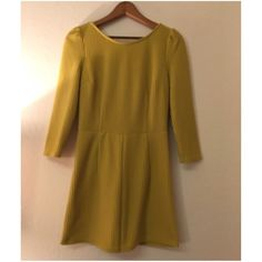 Yellow Green Ribbed dress Yellow green thick ribbed dress with pleated sleeves and v shaped back. This used to be romper, but I altered it to be a dress. You can see the altered stitching in the photos. AKIRA Dresses