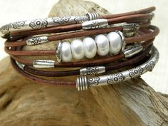 I love this! Greek natural dyed brown leather cord with sterling silver and natural pearls.  TANGRA2009 Etsy