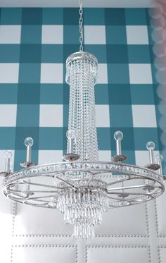 The Crystorama Mercer chandelier's metal work is as beautiful as the waterfall of crystal beads and faceted jewels that adorn it. From below, the metal forms a floral design, like something you might see in a stained glass window. | Del Mar Fans & Lighting