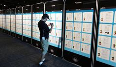 "A display of giant iPhones at the Los Angeles County Fair that show some of Apple's patents Google and Apple spent more on patent lawsuits and acquisitions than they did on R last year...  ""A display of giant iPhones at the Los Angeles County Fair that show some of Apple's patents"""