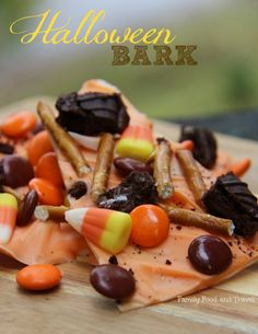 Delicious and easy to make Halloween Bark with candy corn, pretzels, chocolate and smarties. Great for a party or lunchtime treat.