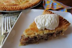 I used to make this but used one crust with meringue topping.  Yum!  Mennonite Girls Can Cook: Sour Cream Raisin Pie