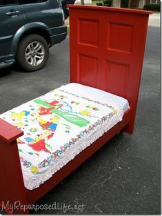 Repurposed Door in to a Toddler Bed.... (this one is for a boy, but could choose different color for a girly bed)