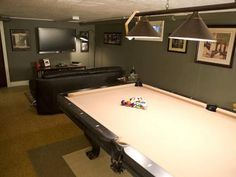 Take a look at how some of the most basic basements were turned into the ultimate guys' hangouts.