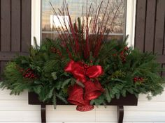 Traditional Window Box with red picks and coordinating red bow.