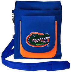 NCAA Florida Gators Travel Purse by Charm14. $29.95. Our traveler bag is also known as the popular hipster bag. This handbag can be worn cross-body over the shoulder or worn around the waist. This hipster purse has plenty of room for storage. Our purse can hold your passport, cell phone, and all important papers. This traveler cell phone pouch is perfect for airport visits or when traveling. This handbag has 4 large compartments. The large flap in the front flips back and is ...